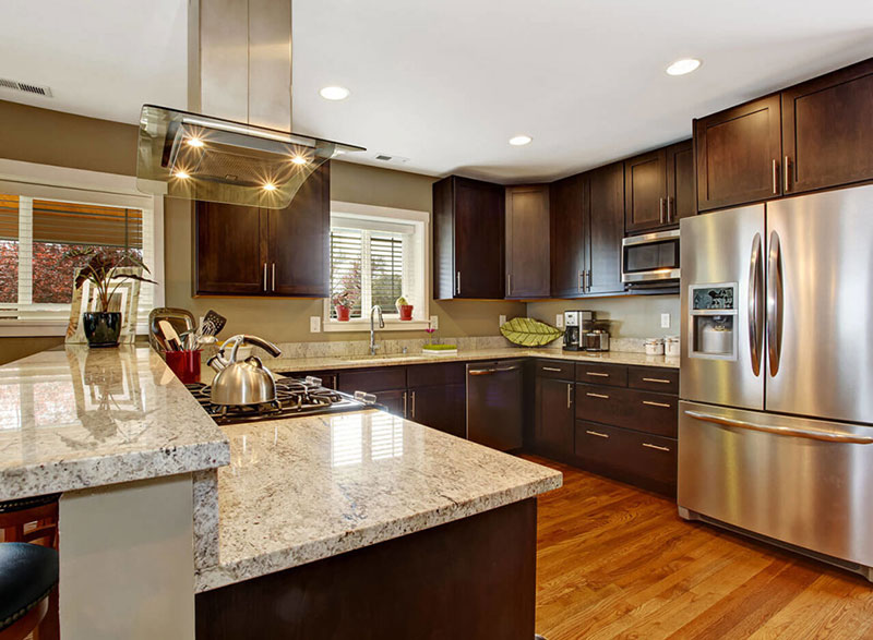 Kashmir white granite countertops with dark cabinets