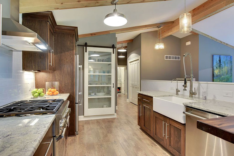 Wood cabinets with white ice granite countertops