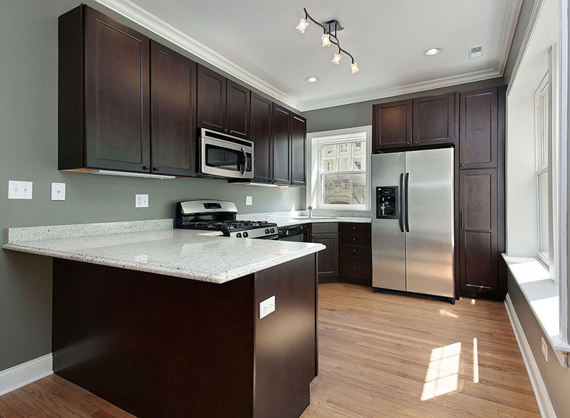 Brown kitchen with Kashmir white countertops