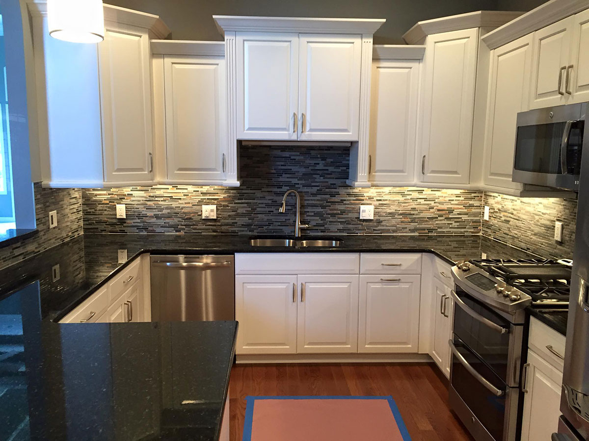 Uba tuba granite countertops pictures cost pros cons for White cabinets granite countertops