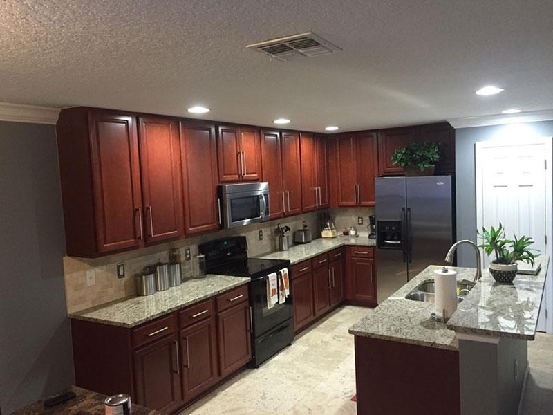 Giallo ornamental granite cherry cabinets
