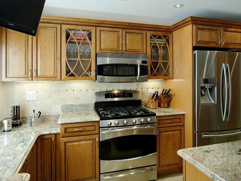 Oak cabinets with white ice granite