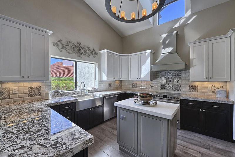 Bianco antico granite countertops with gray cabinets