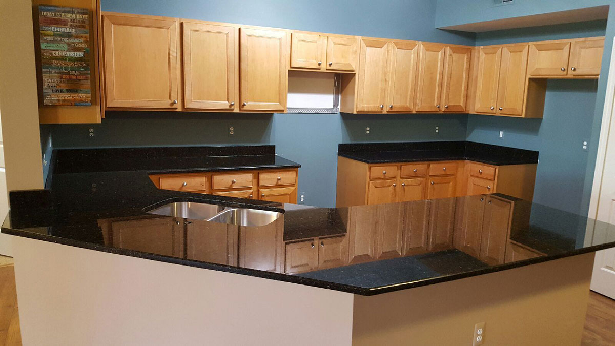 Uba tuba granite and maple cabinets