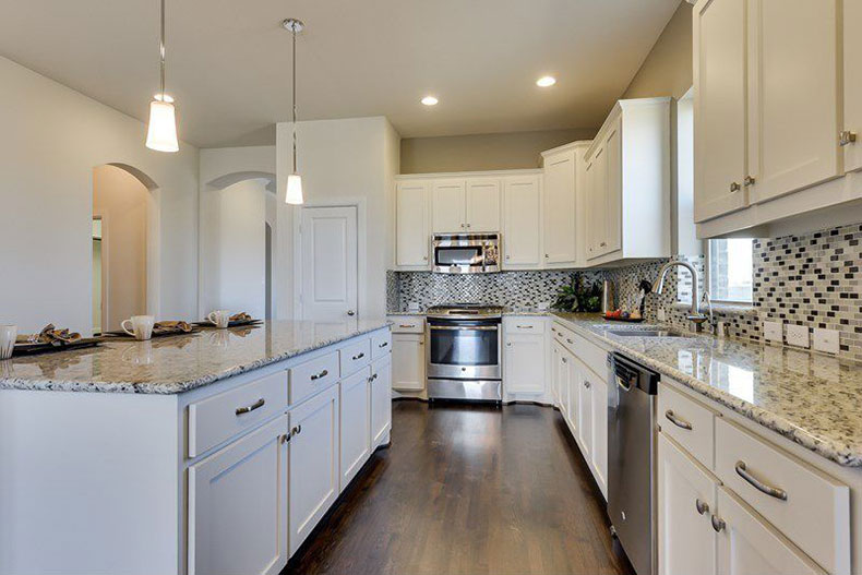 Kashmir white granite countertops with backsplash