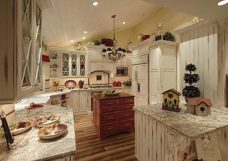 Bianco antico granite countertops with cream cabinets
