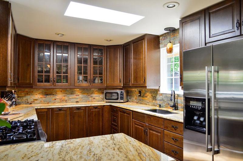 New venetian gold granite countertops with tile backsplash