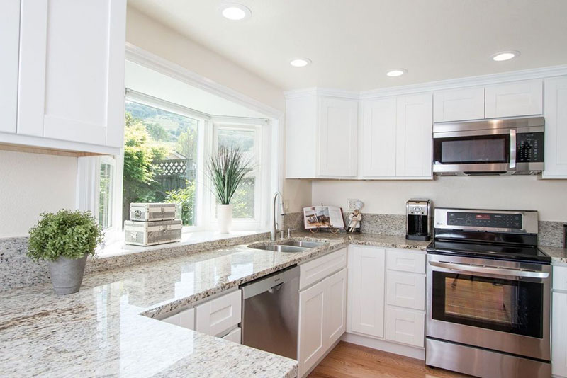 White kitchen with colonial white granite