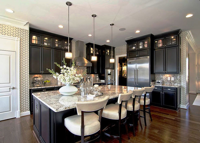 Espresso kitchen cabinets with bianco antico granite countertops