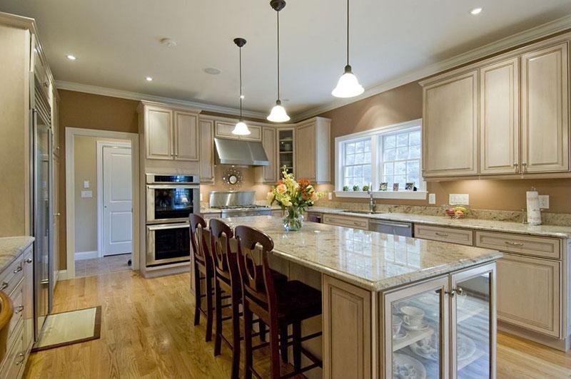 Cream cabinets with river white granite
