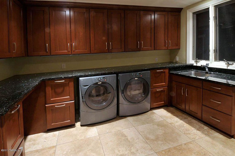 Laundry room with blue pearl granite