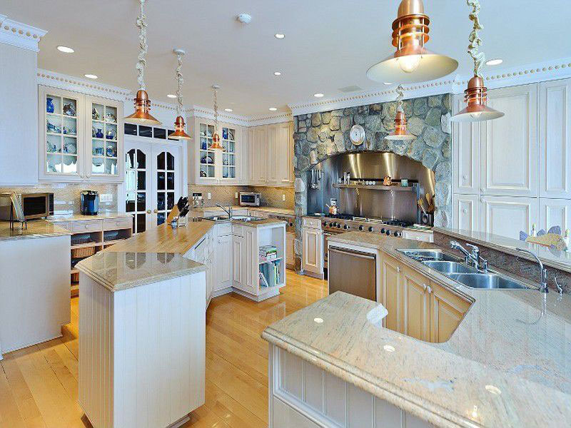 Eclectic kitchen with colonial white granite