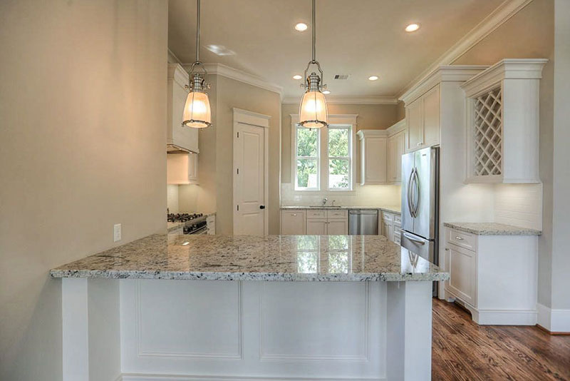 Small white kitchen design with bianco antico countertops