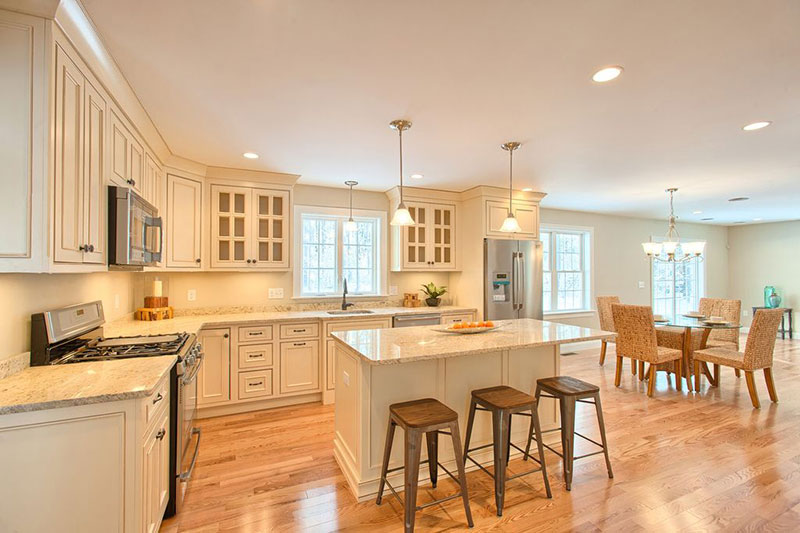 Cream kitchen cabinets with colonial  granite countertops