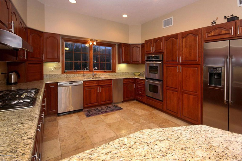 Giallo ornamental granite with brown cabinets
