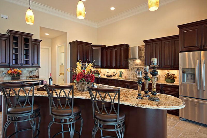 Bianco antico granite countertops with cherry cabinets