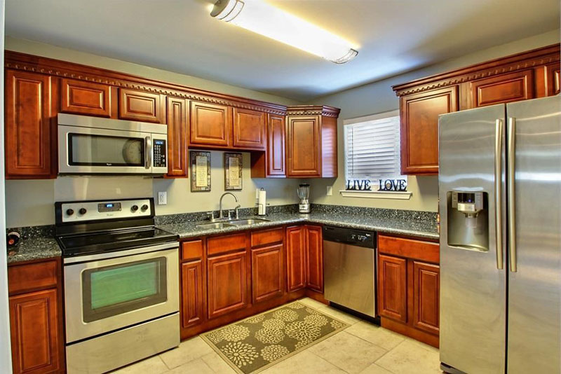 Cherry cabinets with blue pearl countertops