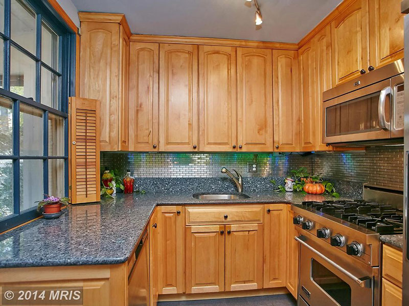 Honey oak cabinets with blue pearl granite