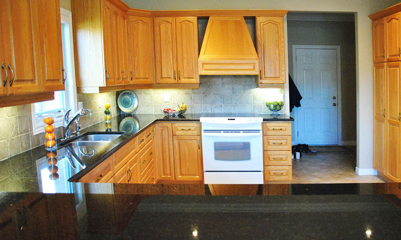 light wood kitchen cabinets with uba tuba granite countertops