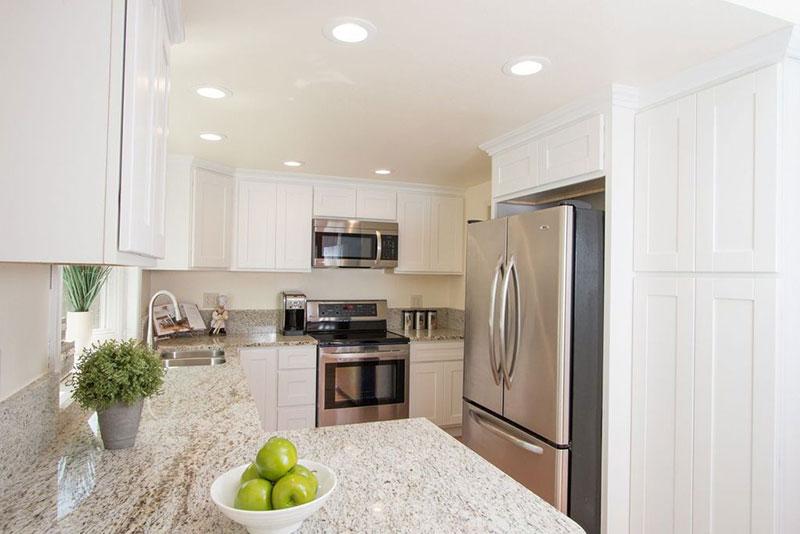 Giallo ornamental light granite white cabinets