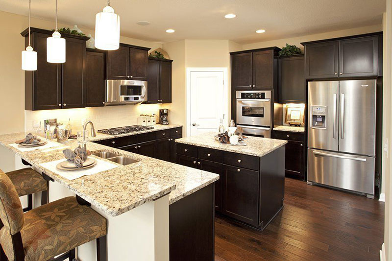 Giallo ornamental granite with black cabinets