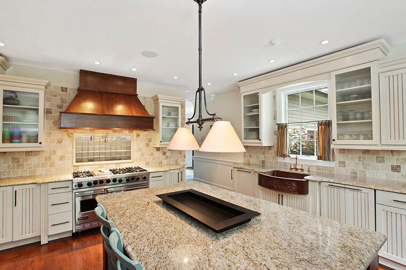 Giallo ornamental granite with antique white cabinets
