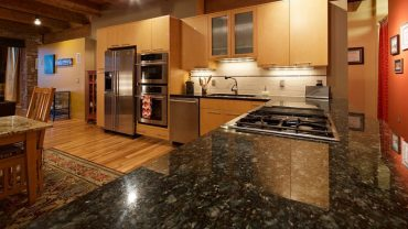 Contemporary kitchen cabinets with uba tuba granite