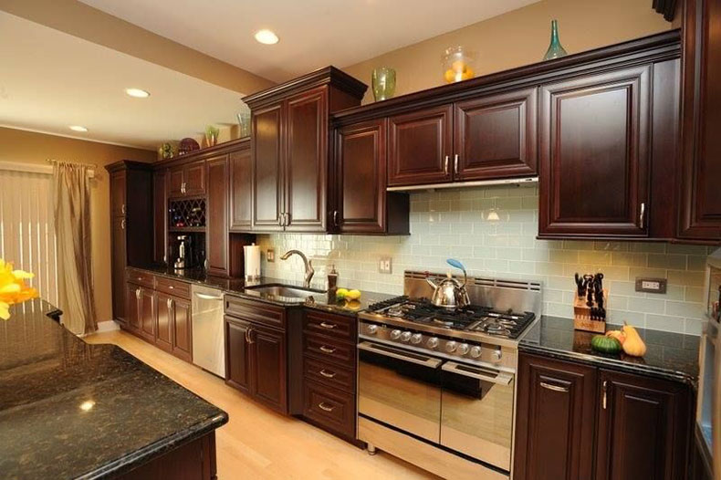 Brown kitchen cabinet with uba tuba granite