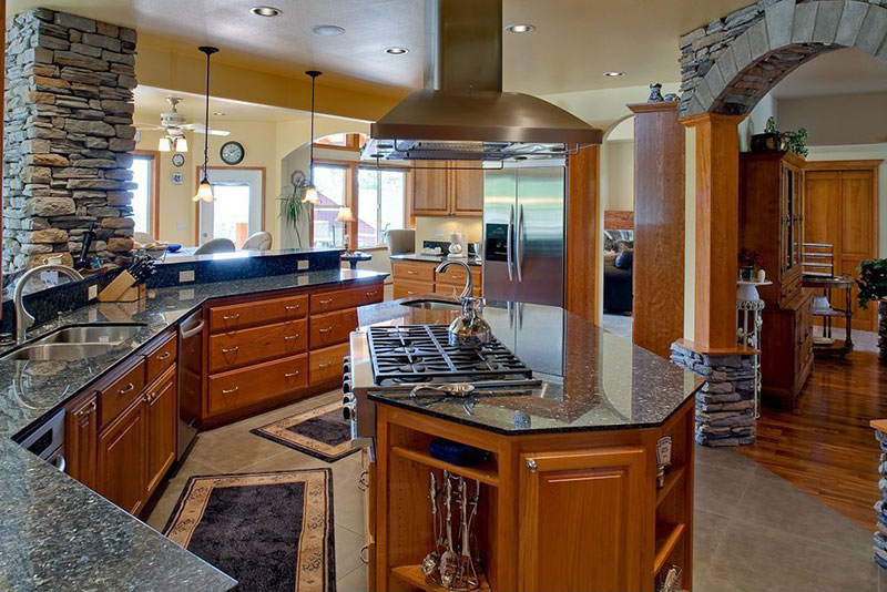 Open plan kitchen with uba tuba granite countertops
