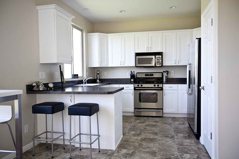 Black granite with white kitchen cabinets