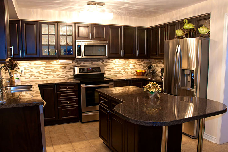 Black granite with black kitchen cabinets