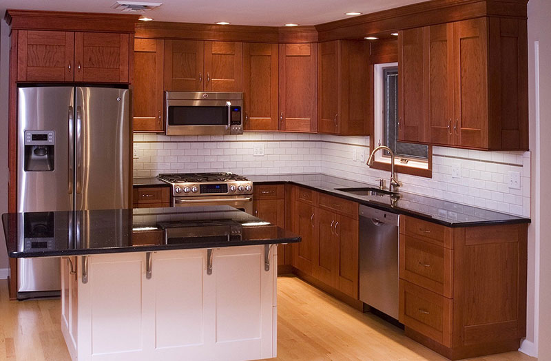 Polished black granite countertops with cherry cabinets