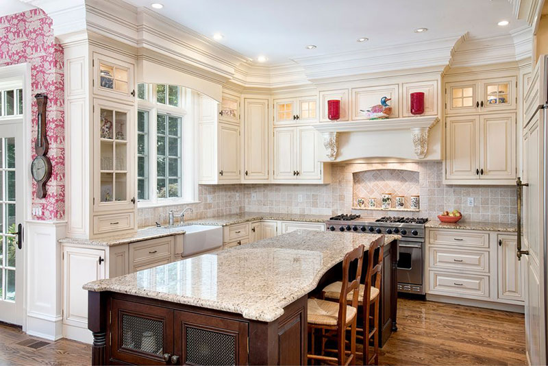 Traditional white kitchen design with alaskan white granite countertops