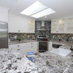 Alaska white granite with subway tile backsplash