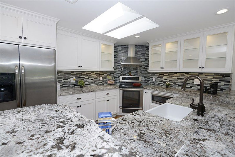 Alaska White Granite Countertops With Subway Tile Backsplash