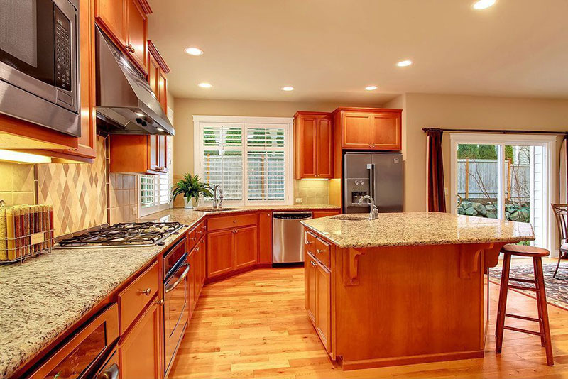 Alaska white granite countertops design ideas with wood cabinets