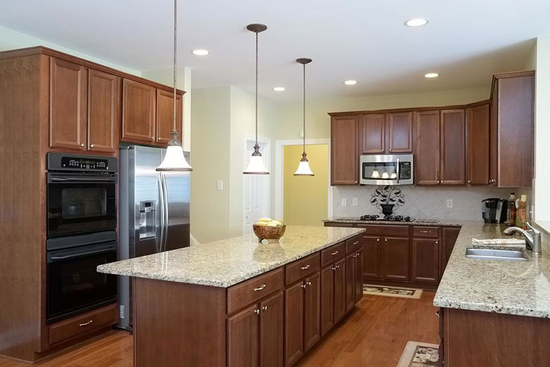 Alaskan white granite with brown cabinets