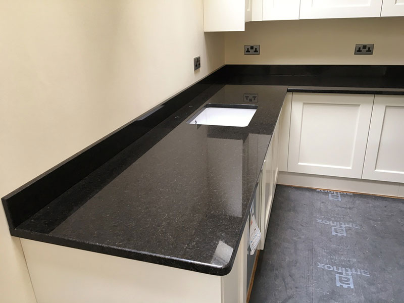 Black galaxy vs black pearl granite countertops