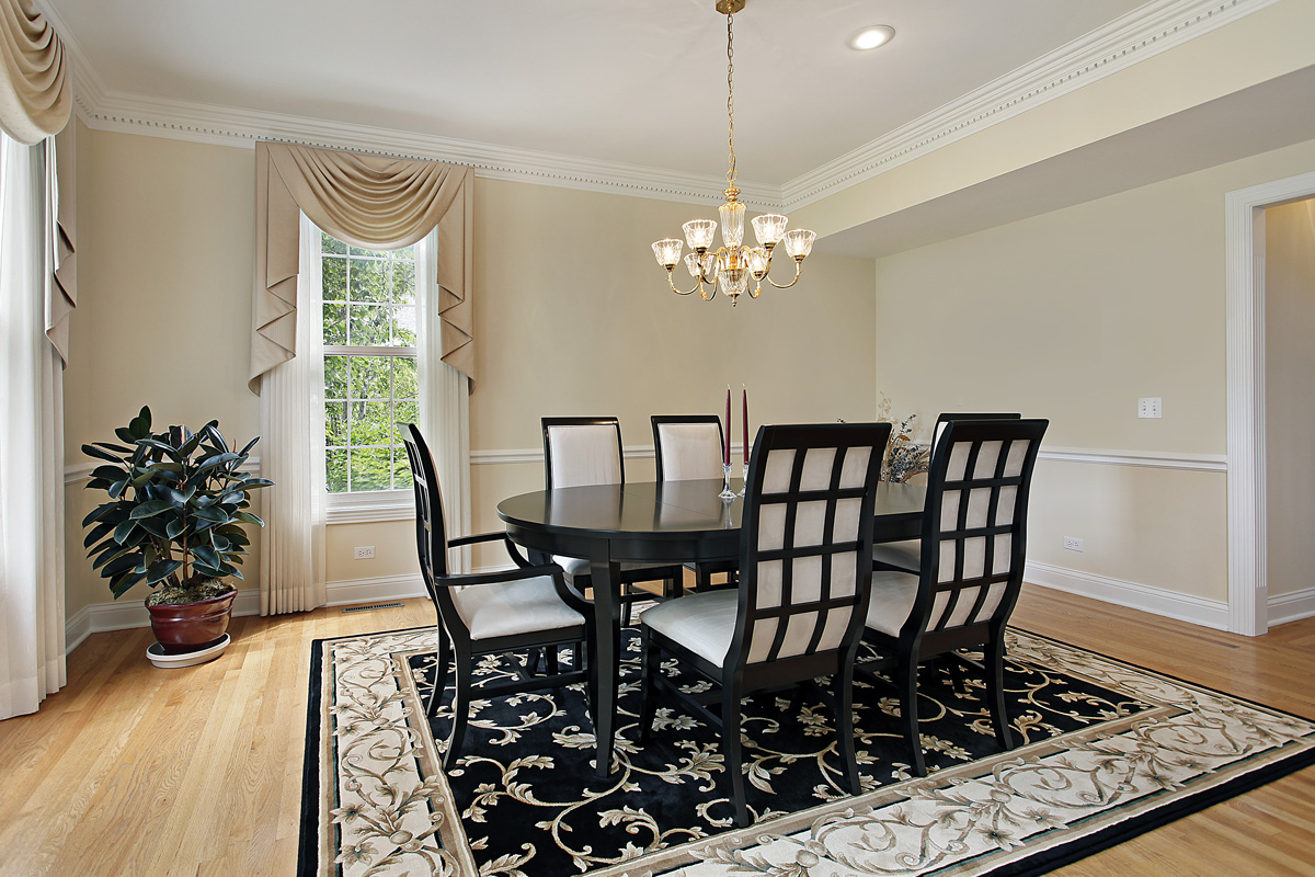 dining room with black and white rug