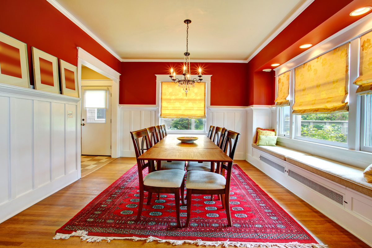 dining room with red rug